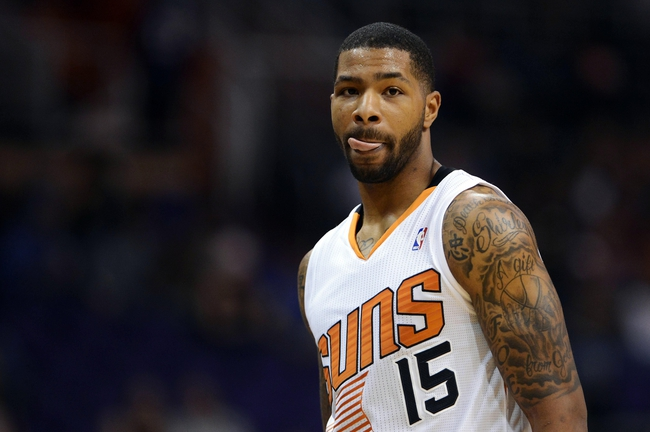Oct 7, 2013; Phoenix, AZ, USA; Phoenix Suns forward Marcus Morris (15) walks up the court in the game against Haifa at US Airways Center. The Suns defeated Haifa 130 to 89.  Mandatory Credit: Jennifer Stewart-USA TODAY Sports