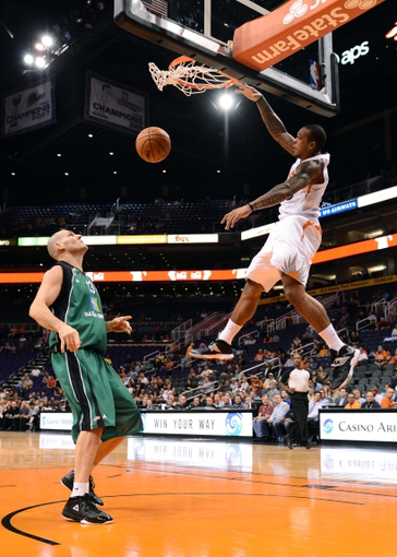 Oct 7, 2013; Phoenix, AZ, USA; Phoenix Suns guard Shannon Brown (26) dunks the ball in the second half over Haifa center Ido Kozikaro (13) at US Airways Center. The Suns defeated Haifa 130 to 89.  Mandatory Credit: Jennifer Stewart-USA TODAY Sports