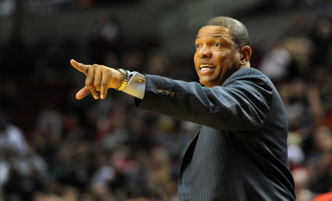 Oct 7, 2013; Portland, OR, USA; Los Angeles Clippers head coach Doc Rivers yells out to his team during the fourth quarter of the game against the Portland Trail Blazers at Moda Center. Mandatory Credit: Steve Dykes-USA TODAY Sports