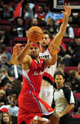 Oct 7, 2013; Portland, OR, USA; Los Angeles Clippers shooting guard Jared Dudley (9) passes the ball as Portland Trail Blazers power forward Joel Freeland (19) defends during the third quarter of the game at Moda Center. Mandatory Credit: Steve Dykes-USA TODAY Sports