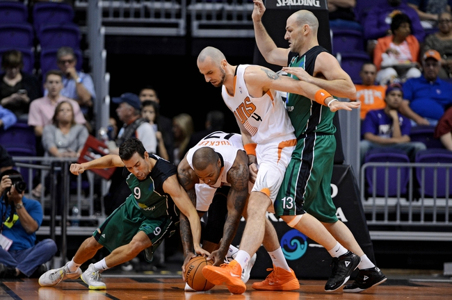Oct 7, 2013; Phoenix, AZ, USA; Phoenix Suns forward P.J Tucker (17) and Haifa guard Moran Roth (9) battle for the ball as center Marcin Gortat (4) boxes out guard Liraz Ariely (12)  in the first half against Haifa at US Airways Center. Mandatory Credit: Jennifer Stewart-USA TODAY Sports
