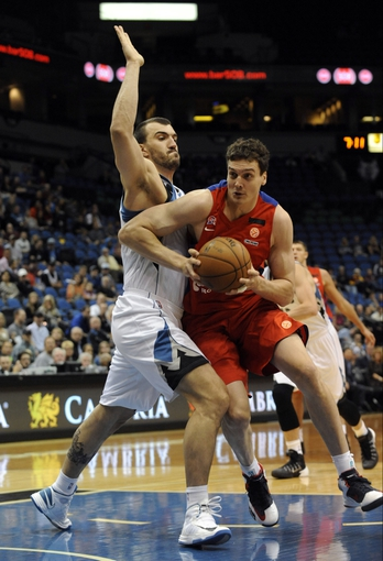 Oct 7, 2013; Minneapolis, MN, USA;  CSKA Moscow center Grigory Shukhovtcov (21) drives past Minnesota Timberwolves center Nikola Pekovic (14) in the second quarter at Target Center. Mandatory Credit: Marilyn Indahl-USA TODAY Sports