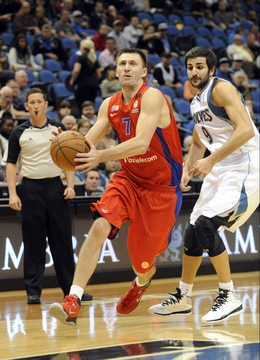 Oct 7, 2013; Minneapolis, MN, USA;  CSKA Moscow guard Vitaly Fridzon (7) drives past Minnesota Timberwolves guard Ricky Rubio (9) in the second quarter at Target Center. Mandatory Credit: Marilyn Indahl-USA TODAY Sports