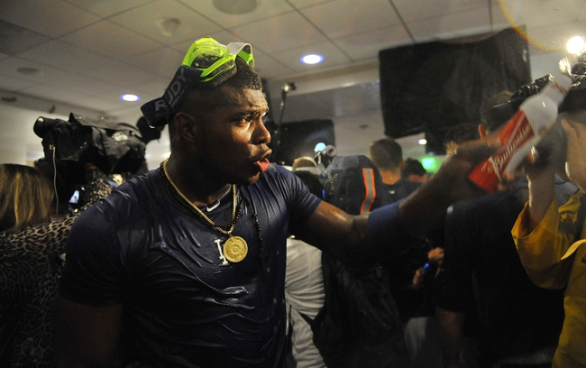 October 7, 2013; Los Angeles, CA, USA; Los Angeles Dodgers right fielder Yasiel Puig (66) celebrates the 4-3 victory against the Atlanta Braves following game four of the National League divisional series playoff baseball game at Dodger Stadium. Mandatory Credit: Gary A. Vasquez TODAY Sports
