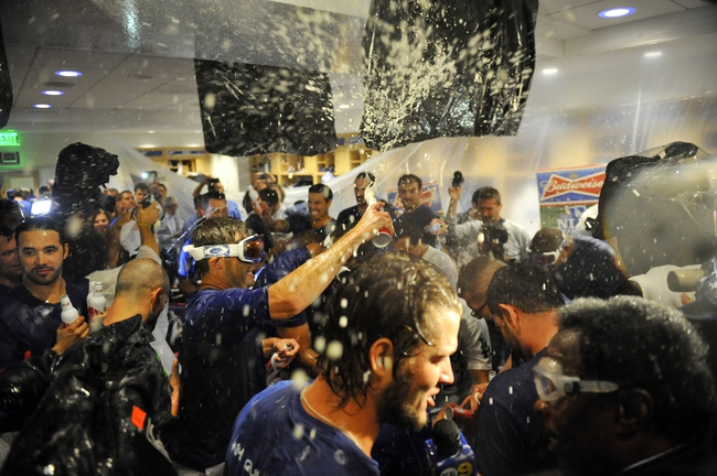 October 7, 2013; Los Angeles, CA, USA; The Los Angeles Dodgers celebrate their 4-3 victory against the Atlanta Braves following game four of the National League divisional series playoff baseball game at Dodger Stadium. Mandatory Credit: Gary A. Vasquez TODAY Sports