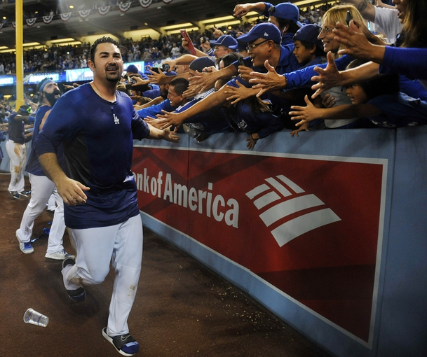 October 7, 2013; Los Angeles, CA, USA; Los Angeles Dodgers first baseman Adrian Gonzalez (23) celebrates the 4-3 victory against the Atlanta Braves following game four of the National League divisional series playoff baseball game at Dodger Stadium. Mandatory Credit: Gary A. Vasquez TODAY Sports