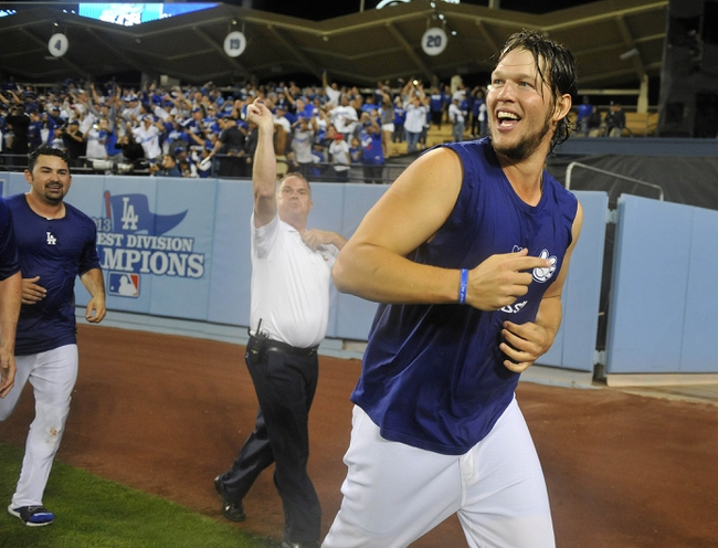 October 7, 2013; Los Angeles, CA, USA; Los Angeles Dodgers starting pitcher Clayton Kershaw (22) celebrates the 4-3 victory against the Atlanta Braves following game four of the National League divisional series playoff baseball game at Dodger Stadium. Mandatory Credit: Gary A. Vasquez TODAY Sports