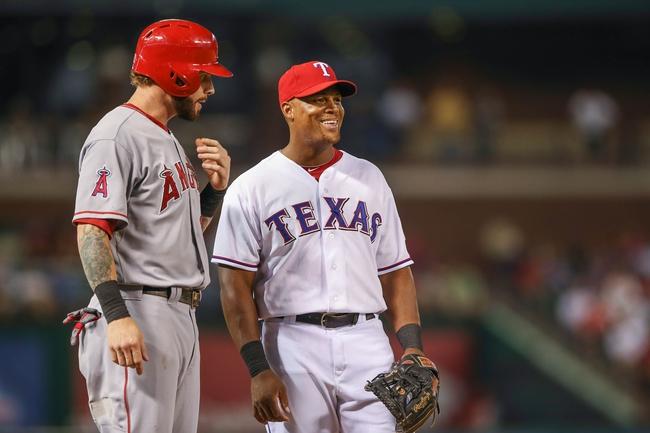 Sep 26, 2013; Arlington, TX, USA; Texas Rangers third baseman Adrian Beltre (29) laughs with Los Angeles Angels designated hitter Josh Hamilton (32) during the game at Rangers Ballpark in Arlington. Mandatory Credit: Kevin Jairaj-USA TODAY Sports