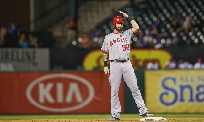 Sep 26, 2013; Arlington, TX, USA; Los Angeles Angels designated hitter Josh Hamilton (32) reacts during the game against the Texas Rangers at Rangers Ballpark in Arlington. Mandatory Credit: Kevin Jairaj-USA TODAY Sports