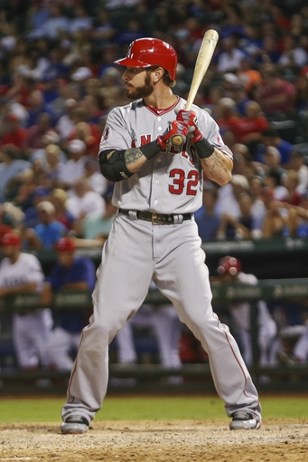 Sep 26, 2013; Arlington, TX, USA;  Los Angeles Angels designated hitter Josh Hamilton (32) bats during the game against the Texas Rangers at Rangers Ballpark in Arlington. Mandatory Credit: Kevin Jairaj-USA TODAY Sports