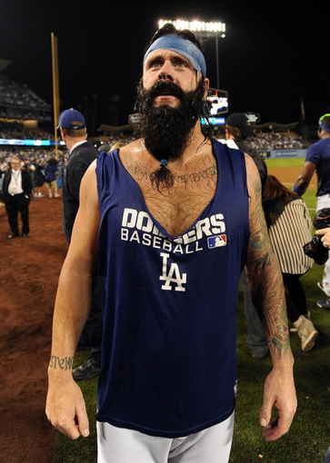 Oct 7, 2013; Los Angeles, CA, USA;  Los Angeles Dodgers relief pitcher Brian Wilson (00) celebrates with fans after defeating the Atlanta Braves 3-2 in game four of the National League divisional series at Dodger Stadium. Dodgers won 3-2. Mandatory Credit: Jayne Kamin-Oncea-USA TODAY Sports