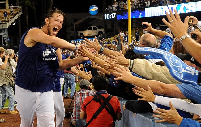 Oct 7, 2013; Los Angeles, CA, USA;  Los Angeles Dodgers starting pitcher Clayton Kershaw (22) celebrates with fans after defeating the Atlanta Braves 3-2 in game four of the National League divisional series at Dodger Stadium. Dodgers won 3-2. Mandatory Credit: Jayne Kamin-Oncea-USA TODAY Sports