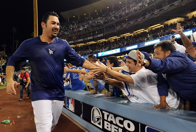 Oct 7, 2013; Los Angeles, CA, USA;  Los Angeles Dodgers first baseman Adrian Gonzalez (23) celebrates with fans after defeating the Atlanta Braves 3-2 in game four of the National League divisional series at Dodger Stadium. Dodgers won 3-2. Mandatory Credit: Jayne Kamin-Oncea-USA TODAY Sports