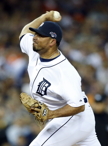 Oct 8, 2013; Detroit, MI, USA; Detroit Tigers relief pitcher Joaquin Benoit throws a pitch against the Oakland Athletics in the 9th inning in game four of the American League divisional series playoff baseball game at Comerica Park. Mandatory Credit: Rick Osentoski-USA TODAY Sports