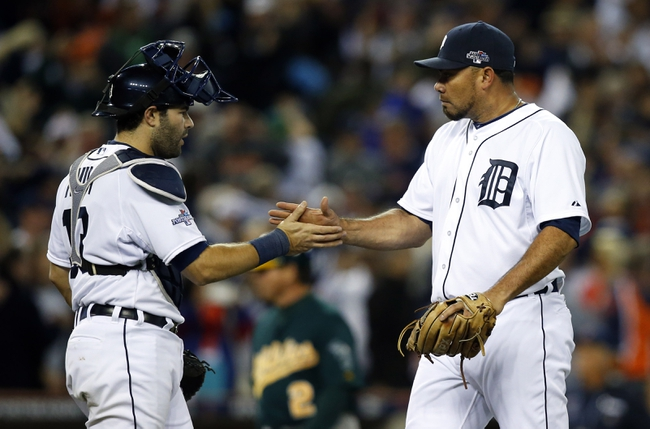 Oct 8, 2013; Detroit, MI, USA; Detroit Tigers relief pitcher Joaquin Benoit (right) shakes hands with catcher Alex Avila (13) after game four of the American League divisional series playoff baseball game against the Oakland Athletics at Comerica Park. Mandatory Credit: Rick Osentoski-USA TODAY Sports