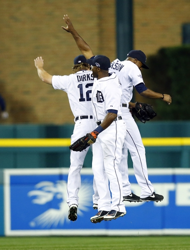Oct 8, 2013; Detroit, MI, USA; Detroit Tigers outfielders Andy Dirks (12) , Torii Hunter (middle) and Austin Jackson celebrate after game four of the American League divisional series playoff baseball game against the Oakland Athletics at Comerica Park. Mandatory Credit: Rick Osentoski-USA TODAY Sports