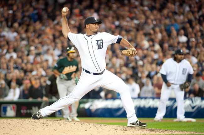 Oct 8, 2013; Detroit, MI, USA; Detroit Tigers relief pitcher Joaquin Benoit (53) throws a pitch during the ninth inning in game four of the American League divisional series against the Oakland Athletics at Comerica Park. Mandatory Credit: Tim Fuller-USA TODAY Sports