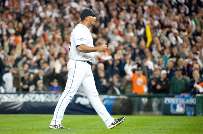 Oct 8, 2013; Detroit, MI, USA; Detroit Tigers relief pitcher Joaquin Benoit (53) celebrates after defeating the Oakland Athletics in game four of the American League divisional series at Comerica Park. Mandatory Credit: Tim Fuller-USA TODAY Sports