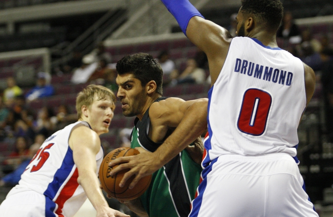 Oct 8, 2013; Auburn Hills, MI, USA; Haifa center Alex Chubrevich (7) gets defended by Detroit Pistons center Andre Drummond (0) during the second quarter at The Palace of Auburn Hills. Mandatory Credit: Raj Mehta-USA TODAY Sports