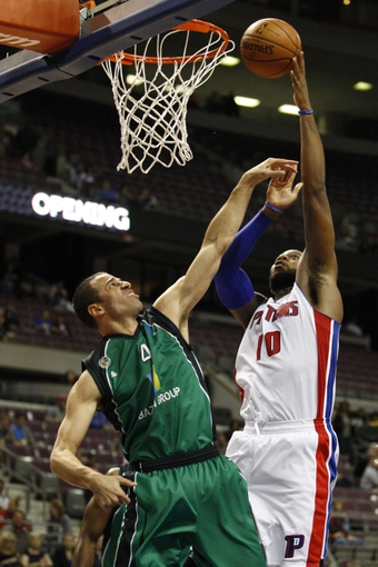 Oct 8, 2013; Auburn Hills, MI, USA; Detroit Pistons center Greg Monroe (10) takes a shot over Haifa center Uri Kokia (4) during the second quarter at The Palace of Auburn Hills. Mandatory Credit: Raj Mehta-USA TODAY Sports