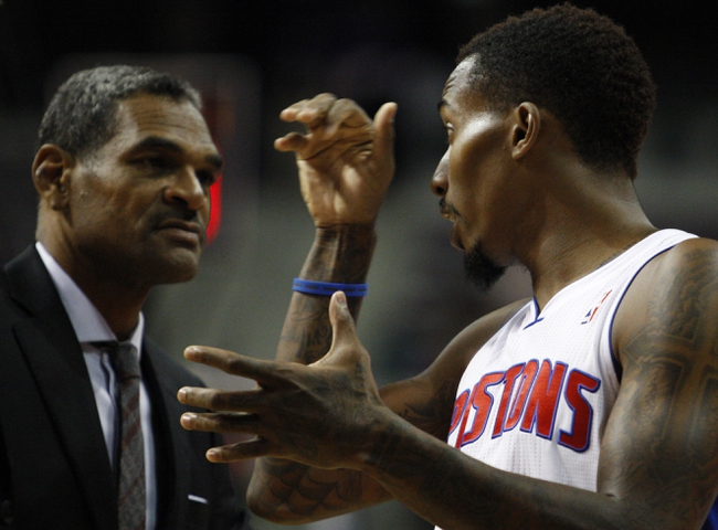 Oct 8, 2013; Auburn Hills, MI, USA; Detroit Pistons head coach Maurice Cheeks listens to point guard Brandon Jennings (7)during the second quarter against Haifa at The Palace of Auburn Hills. Mandatory Credit: Raj Mehta-USA TODAY Sports