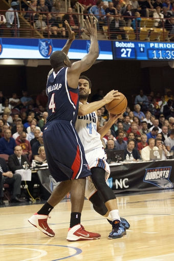 Oct 8, 2013; Asheville, NC, USA; Charlotte Bobcats small forward Jeffery Taylor (44) drives against Atlanta Hawks power forward Paul Millsap (4) during the first half at the U.S. Cellular Center. Mandatory Credit: Jeremy Brevard-USA TODAY Sports