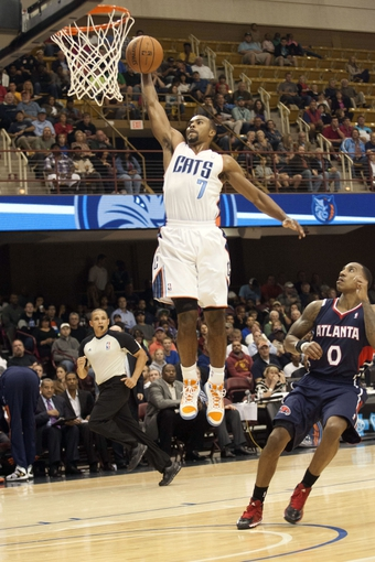 Oct 8, 2013; Asheville, NC, USA; Charlotte Bobcats point guard Ramon Sessions (7) goes up for a shot during the first half against the Atlanta Hawks at the U.S. Cellular Center. Mandatory Credit: Jeremy Brevard-USA TODAY Sports
