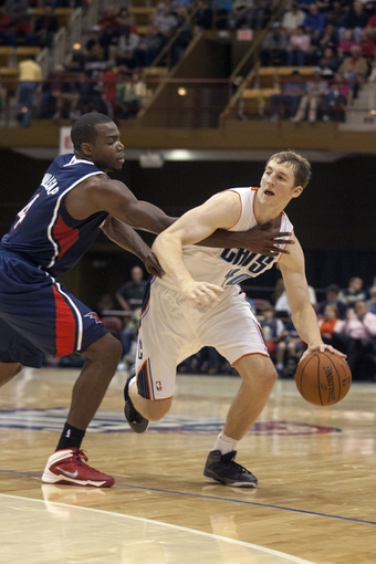 Oct 8, 2013; Asheville, NC, USA;  Charlotte Bobcats power forward Cody Zeller (40) drives the ball around Atlanta Hawks power forward Paul Millsap (4) during the first halfat the U.S. Cellular Center. Mandatory Credit: Jeremy Brevard-USA TODAY Sports