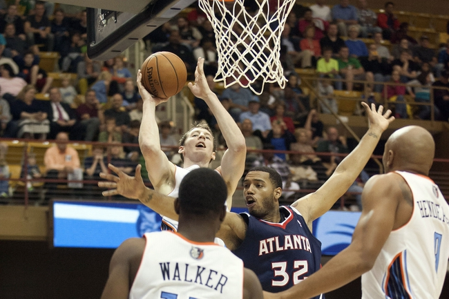 Oct 8, 2013; Asheville, NC, USA;  Charlotte Bobcats power forward Cody Zeller (40) shoots the ball over Atlanta Hawks power forward Mike Scott (32) during the first half at the U.S. Cellular Center. Mandatory Credit: Jeremy Brevard-USA TODAY Sports