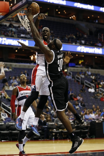 Oct 8, 2013; Washington, DC, USA; Washington Wizards power forward Pops Mensah-Bonsu (44) blocks the shot of Brooklyn Nets power forward Reggie Evans (30) in the third quarter at Verizon Center. The Nets won 111-106 in overtime. Mandatory Credit: Geoff Burke-USA TODAY Sports