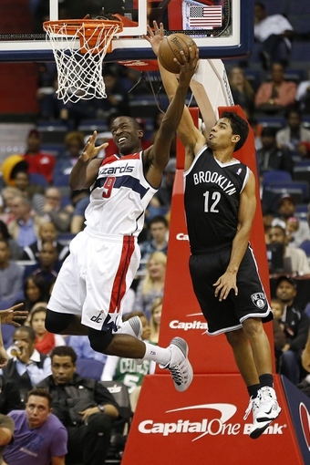 Oct 8, 2013; Washington, DC, USA; Washington Wizards small forward Martell Webster (9) shoots the ball as Brooklyn Nets guard Jorge Gutierrez (12) defends in the fourth quarter at Verizon Center. The Nets won 111-106 in overtime. Mandatory Credit: Geoff Burke-USA TODAY Sports