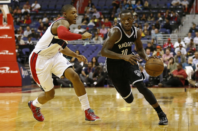 Oct 8, 2013; Washington, DC, USA; Brooklyn Nets point guard Tyshawn Taylor (10) dribbles the ball as Washington Wizards shooting guard Bradley Beal (3) defends in the third quarter at Verizon Center. The Nets won 111-106 in overtime. Mandatory Credit: Geoff Burke-USA TODAY Sports