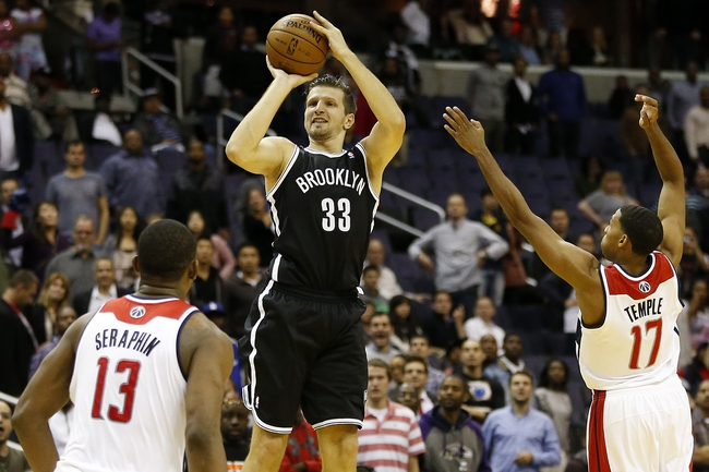 Oct 8, 2013; Washington, DC, USA; Brooklyn Nets power forward Mirza Teletovic (33) shoots the ball over Washington Wizards shooting guard Garrett Temple (17) in the fourth quarter at Verizon Center. The Nets won 111-106 in overtime. Mandatory Credit: Geoff Burke-USA TODAY Sports