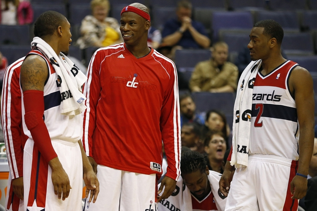 Oct 8, 2013; Washington, DC, USA; Washington Wizards power forward Al Harrington (center) talks with shooting guard Bradley Beal (3) and point guard John Wall (2) on the bench against the Brooklyn Nets in the fourth quarter at Verizon Center. The Nets won 111-106 in overtime. Mandatory Credit: Geoff Burke-USA TODAY Sports