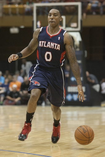 Oct 8, 2013; Asheville, NC, USA;  Atlanta Hawks point guard Jeff Teague (0) brings the ball down the court during the second half against the Charlotte Bobcats at the U.S. Cellular Center.The Hawks defeated the Bobcats 87-85.  Mandatory Credit: Jeremy Brevard-USA TODAY Sports