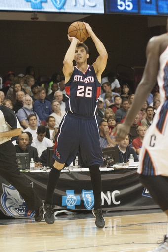 Oct 8, 2013; Asheville, NC, USA; Atlanta Hawks shooting guard Kyle Korver (26) shoots a three point basket during the second half against the Charlotte Bobcats at the U.S. Cellular Center.The Hawks defeated the Bobcats 87-85.  Mandatory Credit: Jeremy Brevard-USA TODAY Sports