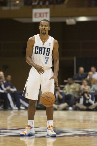 Oct 8, 2013; Asheville, NC, USA; Charlotte Bobcats point guard Ramon Sessions (7) brings the ball down the court during the first half against the Atlanta Hawks at the U.S. Cellular Center.The Hawks defeated the Bobcats 87-85.  Mandatory Credit: Jeremy Brevard-USA TODAY Sports