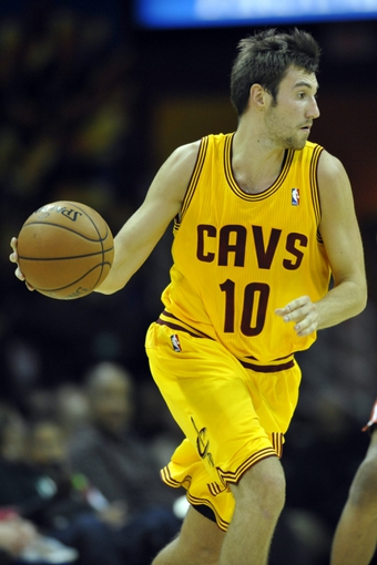 Oct 8, 2013; Cleveland, OH, USA; Cleveland Cavaliers shooting guard Sergey Karasev (10) dribbles the ball against the Milwaukee Bucks in the fourth quarter at Quicken Loans Arena. Mandatory Credit: David Richard-USA TODAY Sports