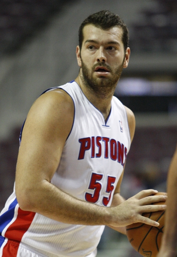 Oct 8, 2013; Auburn Hills, MI, USA; Detroit Pistons center Josh Harrellson (55) looks for an open teammate during the fourth quarter against Haifa at The Palace of Auburn Hills. Pistons beat Haifa 91-69. Mandatory Credit: Raj Mehta-USA TODAY Sports