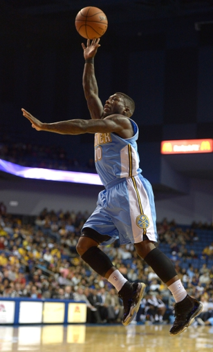 Oct 8, 2013; Ontario, CA, USA; Denver Nuggets guard Nate Robinson (10) shoots the ball against the Los Angeles Lakers at Citizens Business Bank Arena. The Lakers defeated the Nuggest 90-88. Mandatory Credit: Kirby Lee-USA TODAY Sports