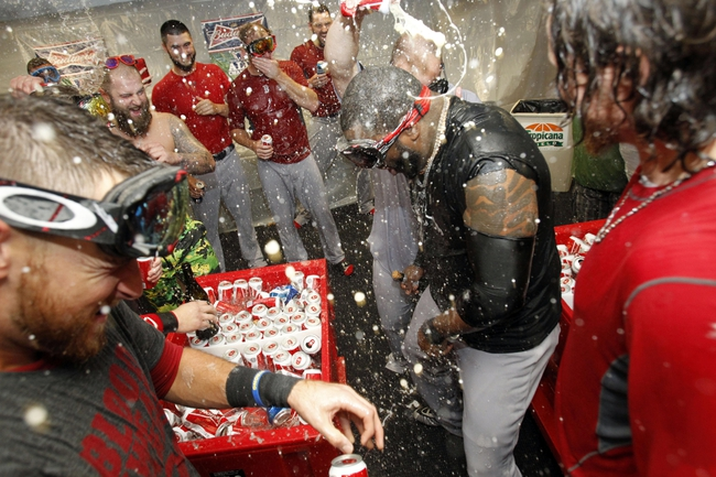 Oct 8, 2013; St. Petersburg, FL, USA; Boston Red Sox designated hitter David Ortiz (center) and teammates celebrate in the locker room as they pour champagne on them as they beat the Tampa Bay Rays of game four of the American League divisional series at Tropicana Field. Boston Red Sox defeated theTampa Bay Rays 3-1. Mandatory Credit: Kim Klement-USA TODAY Sports