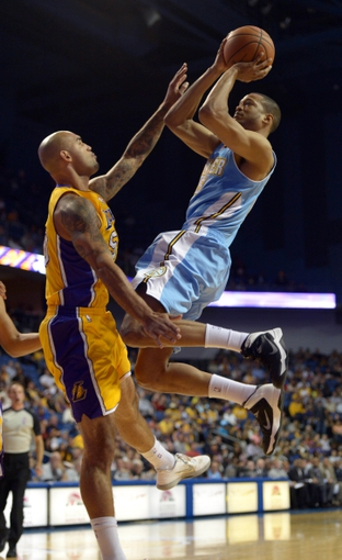Oct 8, 2013; Ontario, CA, USA; Denver Nuggets forward Anthony Randolph (15) is defended by Los Angeles Lakers forward Robert Sacre (50) at Citizens Business Bank Arena. The Lakers defeated the Nuggest 90-88. Mandatory Credit: Kirby Lee-USA TODAY Sports
