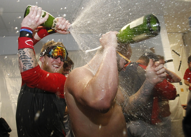 Oct 8, 2013; St. Petersburg, FL, USA; Boston Red Sox left fielder Mike Carp (left) and first baseman Mike Napoli (right) pours champagne on each other as they celebrate beating the Tampa Bay Rays of the American League divisional series at Tropicana Field. Boston Red Sox defeated theTampa Bay Rays 3-1. Mandatory Credit: Kim Klement-USA TODAY Sports