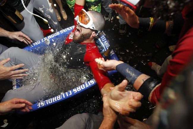 Oct 8, 2013; St. Petersburg, FL, USA; Boston Red Sox bull pen catcher Brian Abraham is dunked in the cooler as they celebrate beating the Tampa Bay Rays in game four of the American League divisional series at Tropicana Field. Boston Red Sox defeated theTampa Bay Rays 3-1. Mandatory Credit: Kim Klement-USA TODAY Sports