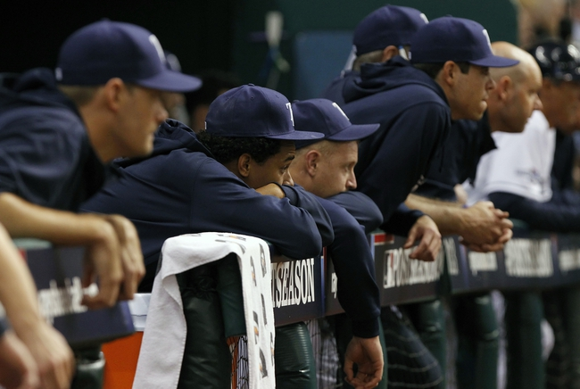 Oct 8, 2013; St. Petersburg, FL, USA; Tampa Bay Rays pitcher Chris Archer (22), pitcher Alex Cobb (53) and teammates look on from the dugout during the ninth inning against the Boston Red Sox of game four of the American League divisional series at Tropicana Field. Boston Red Sox defeated theTampa Bay Rays 3-1. Mandatory Credit: Kim Klement-USA TODAY Sports