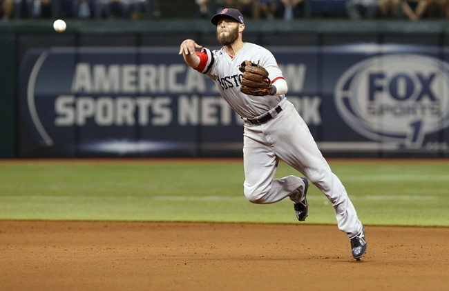 Oct 8, 2013; St. Petersburg, FL, USA; Boston Red Sox second baseman Dustin Pedroia (15) throws the ball to first base for an out during the ninth inning against the Tampa Bay Rays of game four of the American League divisional series at Tropicana Field. Boston Red Sox defeated theTampa Bay Rays 3-1. Mandatory Credit: Kim Klement-USA TODAY Sports