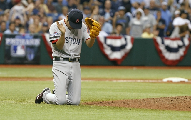 Oct 8, 2013; St. Petersburg, FL, USA; Boston Red Sox relief pitcher Koji Uehara (19) reacts during the ninth inning against the Tampa Bay Rays of game four of the American League divisional series at Tropicana Field. Boston Red Sox defeated theTampa Bay Rays 3-1. Mandatory Credit: Kim Klement-USA TODAY Sports
