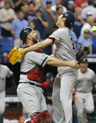 Oct 8, 2013; St. Petersburg, FL, USA; Boston Red Sox relief pitcher Koji Uehara (19) and catcher David Ross (3) hug and celebrate after they beat the Tampa Bay Rays in game four of the American League divisional series at Tropicana Field. Boston Red Sox defeated theTampa Bay Rays 3-1. Mandatory Credit: Kim Klement-USA TODAY Sports