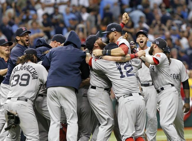 Oct 8, 2013; St. Petersburg, FL, USA;Boston Red Sox left fielder Jonny Gomes (5), third baseman Will Middlebrooks (16), first baseman Mike Napoli (12) hug and celebrate with teammates after they beat the Tampa Bay Rays in game four of the American League divisional series at Tropicana Field. Boston Red Sox defeated theTampa Bay Rays 3-1. Mandatory Credit: Kim Klement-USA TODAY Sports