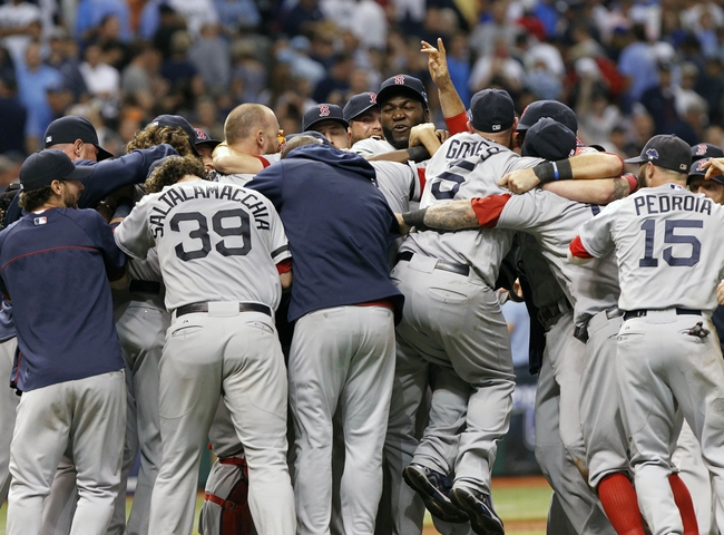 Oct 8, 2013; St. Petersburg, FL, USA; Boston Red Sox designated hitter David Ortiz (34)hug and celebrate with teammates as they rush on the field after they beat the Tampa Bay Rays in game four of the American League divisional series at Tropicana Field. Boston Red Sox defeated theTampa Bay Rays 3-1. Mandatory Credit: Kim Klement-USA TODAY Sports